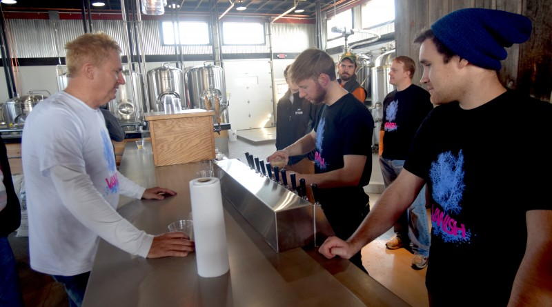 Black Hops Farm's Jonathan Staples, left, at the bar in the Vanish tasting room. (Loudoun Now/File Art)
