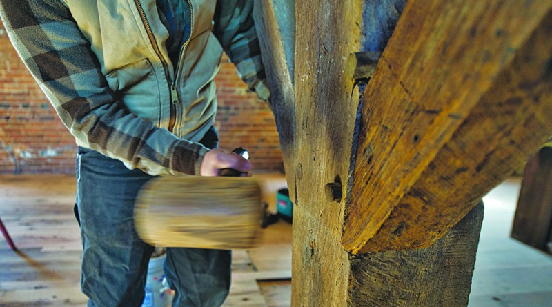 UNITED STATES - March 21,2016:Joe Reidel drives a wooden peg into a timber support beam in a old bank barn thats being restored north of Hamilton by Cochran's Stone Masonry & Timberframing of Lincoln Virginia. (Photo by Douglas Graham/Loudoun Now)