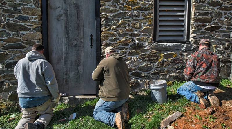 UNITED STATES - March 21,2016: Workers point up an old stone wall on an old bank barn thats being restored north of Hamilton by Cochran's Stone Masonry & Timberframing of Lincoln Virginia. (Photo by Douglas Graham/Loudoun Now)
