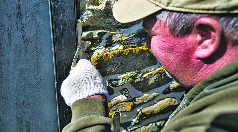 Will Brown points up an old stone wall on an old bank barn thats being restored north of Hamilton by Cochran's Stone Masonry & Timberframing of Lincoln.   (Photo by Douglas Graham/Loudoun Now)