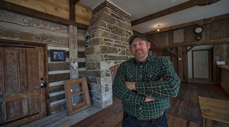 Allen Cochran of Cochran's Stone Masonry & Timberframing poses for a photo in his showroom which is the old Janney Country Store in Lincoln.   (Photo by Douglas Graham/Loudoun Now)