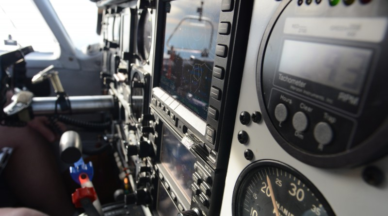 The instrument cluster on Dennis Boykin's Piper Comanche has been upgraded with modern avionics and navigation. (Renss Greene/Loudoun Now)