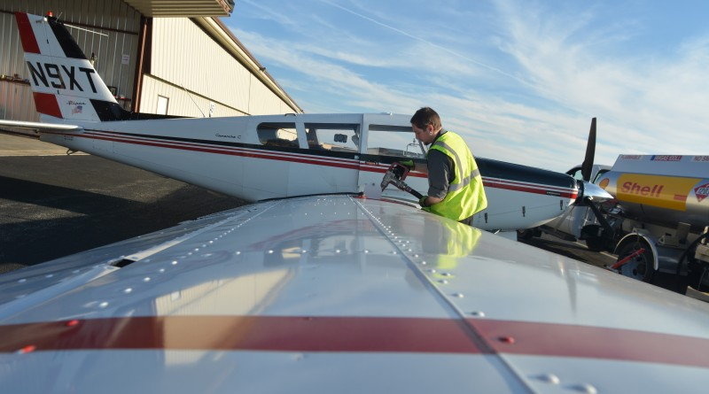 Dennis Boykin's 1969 Piper Comanche C is refueled at Leesburg Executive Airport after a day of flying. (Renss Greene/Loudoun Now)