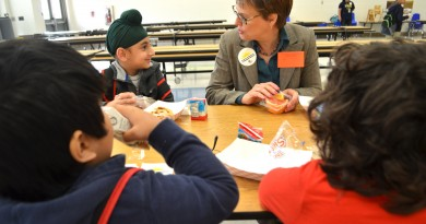 USDA's Food, Nutrition and Consumer Services' Deputy Undersecretary Katie Wilson enjoys breakfast with 6-year-old Jasman and other Frederick Douglass Elementary School kindergarteners Thursday. The number of Frederick Douglass students eating school breakfast has more than doubled in the past year. (Danielle Nadler/Loudoun Now)