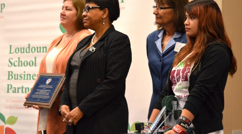 Park View High School sophomore Yailin Gonzalez, far right, stands with representatives from Women in Technology as they accept an award for supporting young girls interested in STEM-related careers. (Danielle Nadler/Loudoun Now)