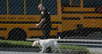 A Loudoun County K-9 unit sweeps the school system's main garage Wednesday. (Renss Greene/Loudoun Now)