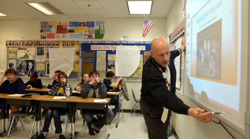 Civics teacher George Cassutto shares the story of his parents, who survived the Holocaust, with students at Harmony and Eagle Ridge middle schools via Skype. (Danielle Nadler/Loudoun Now)