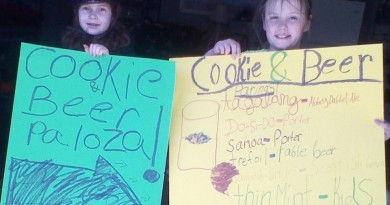 Girl Scouts from Troop 2718 show off signs they've made for Saturday afternoon at Vanish. (Nensi Fiorenini)