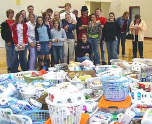 A local church youth group collected dozens of baskets for the Holiday Coalition as part of Make a Difference Day, sponsored by Loudoun Volunteer Services. (Loudoun County Government)