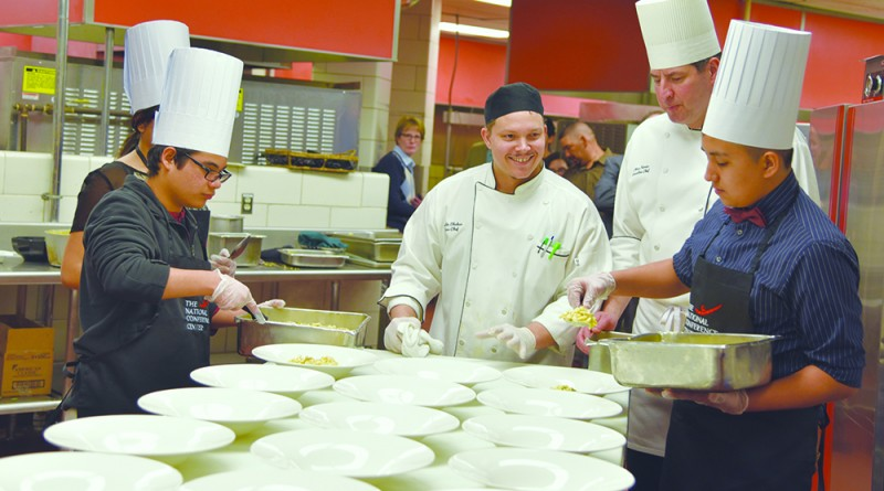 The students from the Riverside High School culinary competition prepare their winning dish with help from The National's Executive Chef Chris Ferrier. (Marcia Massenberg/The National)