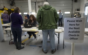 Poll worker Lisa O'Neill helps voters at the Philomont Firehouse during Super Tuesday voting. Turnout was brisk and steady at 8 a.m. out in western Loudoun's polling stations in the Blue Ridge District.  (Douglas Graham/Loudoun Now)