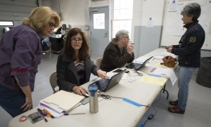 Poll workers Dianna Price, Lisa O'Neill and Terry O'Neill help voters at the Philomont Fire House District during Super Tuesday voting. Turnout was brisk and steady at 8 a.m. out in western Loudoun's polling Locations in the Blue Ridge District.  (Douglas Graham/Loudoun Now)