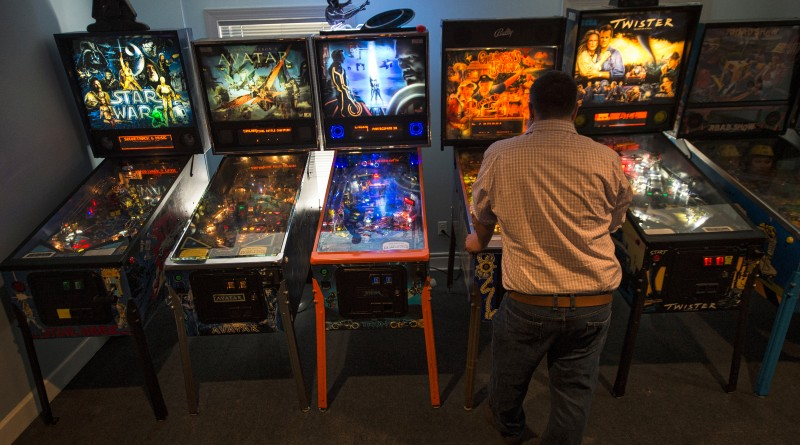 """UNITED STATES - March 28, 2016: Eric """"Zootie"""" Sutton plays pinball at Zootie's Vapors the new vaping store in Leesburg Virginia on Wirt Street. Vaping as it is called is to use a vaporizer to produce smoke paper. The process involves applying heat to a liquid which generates vapor. The user, called a vaper (smoker in traditional cigarette circles) gets their nicotine hit through inhaling the almost odorless vapor (smoking equivalent of ÔsmokeÕ).  (Photo by Douglas Graham/Loudoun Now)"""