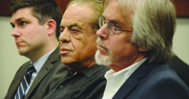 Attorney Andrew Painter, Young Group president Robert Young, and Young Group Senior Vice President Joe Wetzel listen March 24 to a request to rehear the Board of Zoning Appeals' approval of The Young Group's Davis Church plans.  (Renss Greene/Loudoun Now)