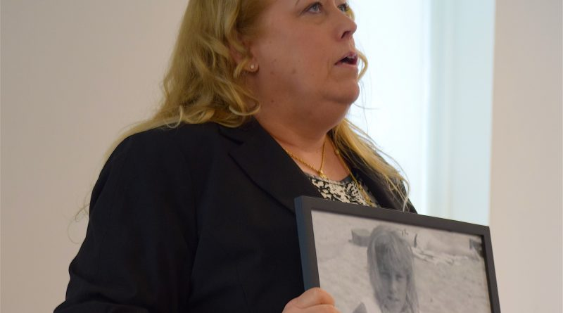 Human Trafficking victims advocate Barbara Amaya holds a photo of herself at age 12, when she was taken to New York City to work the streets as a prostitute.