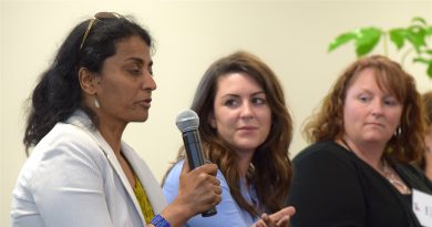 NeuStar's Meenakshi Parthasarathy answers a question as Amazon's Stephanie Spiers  and Telos' Linda Decker look on.