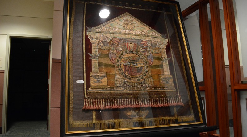 The 21st USCT banner stands on display by an entrance to the county board room. (Renss Greene/Loudoun Now)