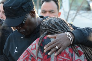 Kevin Wallace comforts Tina Wallace, Shaneka Owens' mother and Christina Fisher's godmother. (Renss Greene/Loudoun Now)
