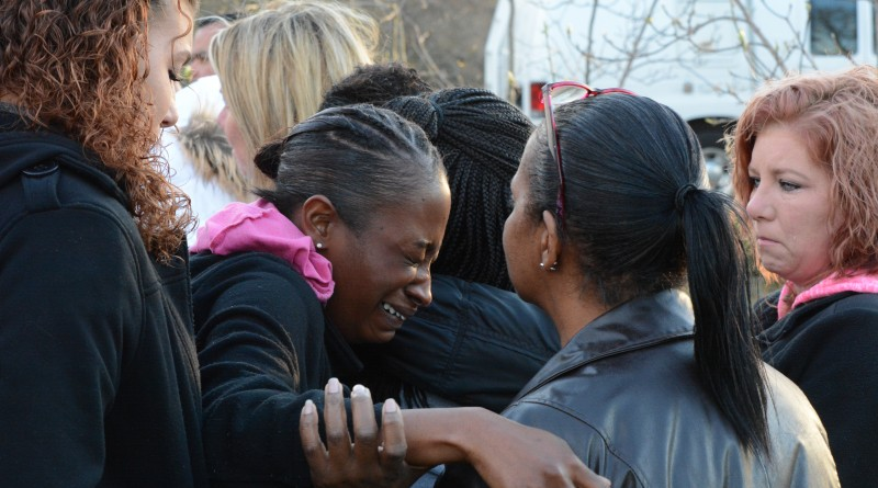 People at the vigil comfort one another. (Renss Greene/Loudoun Now)