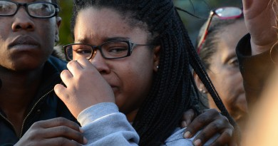 Christina Fisher's daughter, Natajia, weeps during a vigil in her mother's honor. (Renss Greene/Loudoun Now)