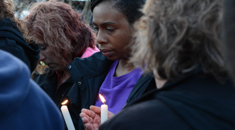 Syreeta Hughes holds a candle during the vigil for Christina Fisher. (Renss Greene/Loudoun Now)
