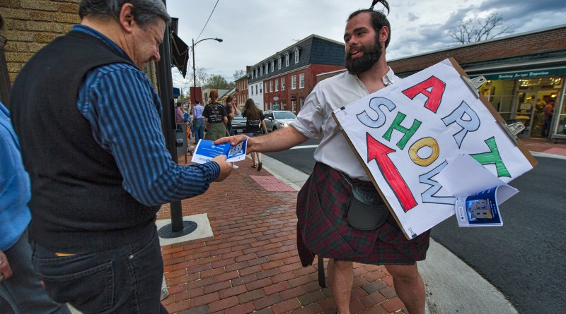 Danny Wehr hands out flyers for a an art show during First Friday.   (Photo by Douglas Graham/Loudoun Now)