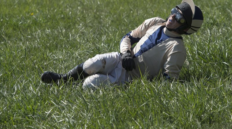 A thrown jockey waits for medical help at the Loudoun Hunt Point to Point Races on Sunday, April 17, 2016.  (Photo by Douglas Graham/Loudoun Now)