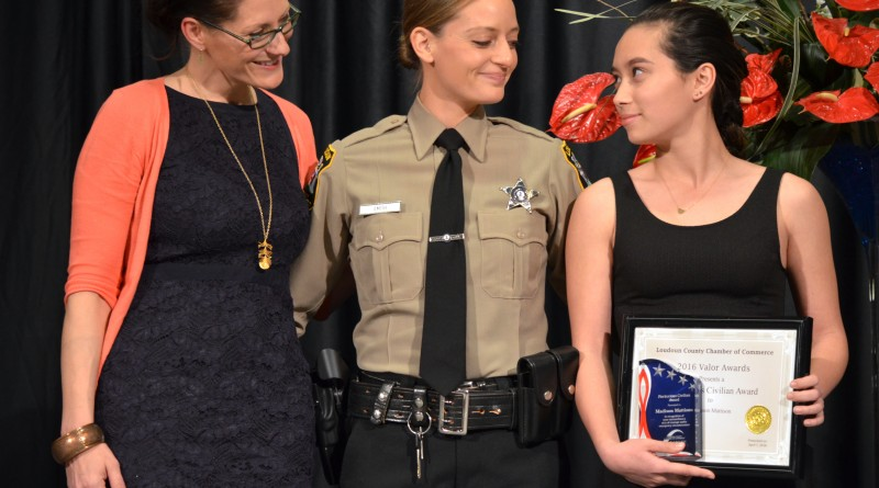 Madison Mattison, right, looks toward her mother, Denise Mattison, far left, and Loudoun County deputy Casey Smith, who was one of the first officers on the scene of the homicide. (Danielle Nadler/Loudoun Now)