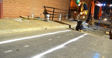 Night work by crews to install a larger water line under East Market Street was called off this week because of noise complaints. (Danielle Nadler/Loudoun Now)