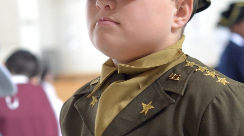 Christian, a fourth-grader at Catoctin Elementary School, posed as the stoic Gen. George C. Marshall at the school's annual Wax Museum. (Danielle Nadler/Loudoun Now)