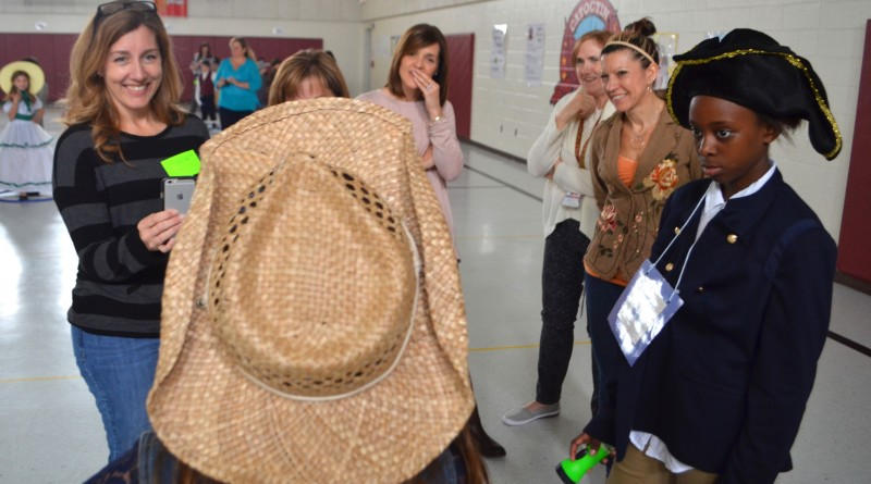 Hundreds of parents and students strolled through the Wax Museum. Here, visitors learn about Patsy Cline. (Danielle Nadler/Loudoun Now)