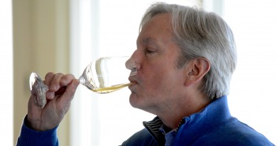 Jay Youmans, one of only 38 Masters of Wine in the United States, tastes Michael Shaps' Wineworks's 2014 Petit Manseng. (Renss Greene/Loudoun Now)