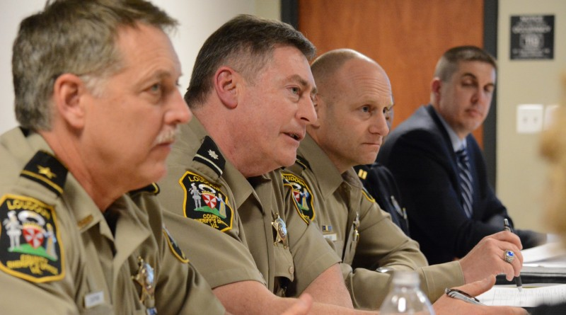 Loudoun Sheriff Michael Chapman, LCSO Lt. Col. Robert Buckman, LCSO Lt. Col. Mark Poland, and Leesburg Captain Carl Maupin sit in on a joint police committee meeting. Interim Leesburg Police Department Chief Vanessa Grigsby is obscured. (Renss Greene/Loudoun Now)