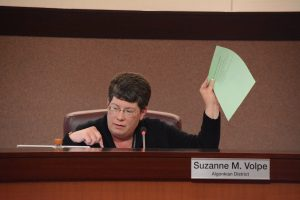 Supervisor Suzanne M. Volpe (R-Algonkian) holds up a statement, unanimously endorsed by the Board of Supervisors, which she will deliver to the CTB in May. (Renss Greene/Loudoun Now)