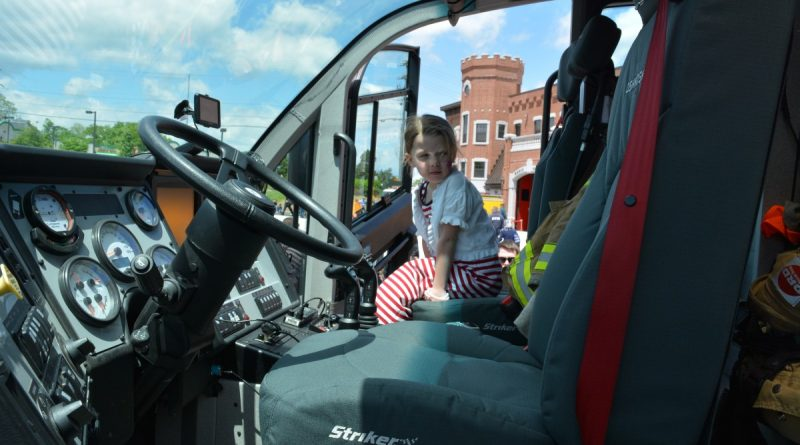 A girl tries out the view from a Metropolitan Washington Airports Authority fire engine. (Renss Greene/Loudoun Now)