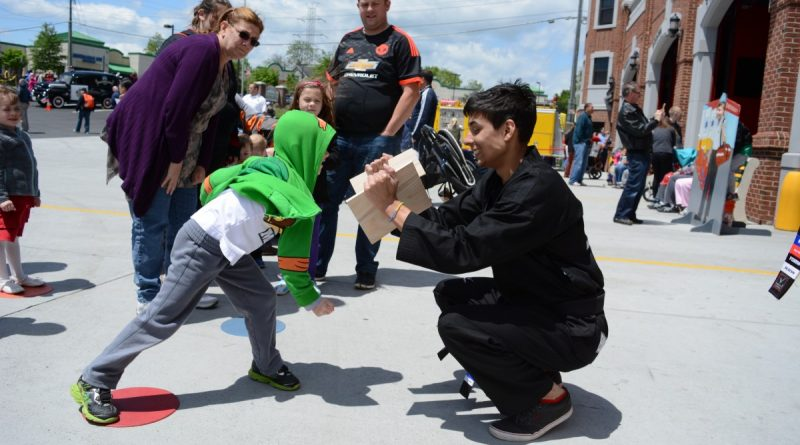 Kids at the grand opening got to try their hand at breaking boards, courtesy of Top Kick. (Renss Greene/Loudoun Now)