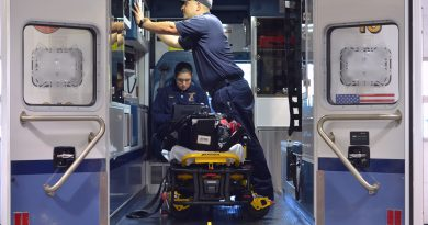 A paramedic and firefighter EMT prep an ambulance for service Tuesday afternoon at the Loudoun County Volunteer Rescue Squad station on Catoctin Circle in Leesburg. (Danielle Nadler/Loudoun Now)