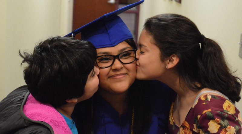 Jennifer Davila gets a kiss from her sisters after the ceremony. (Renss Greene/Loudoun Now)