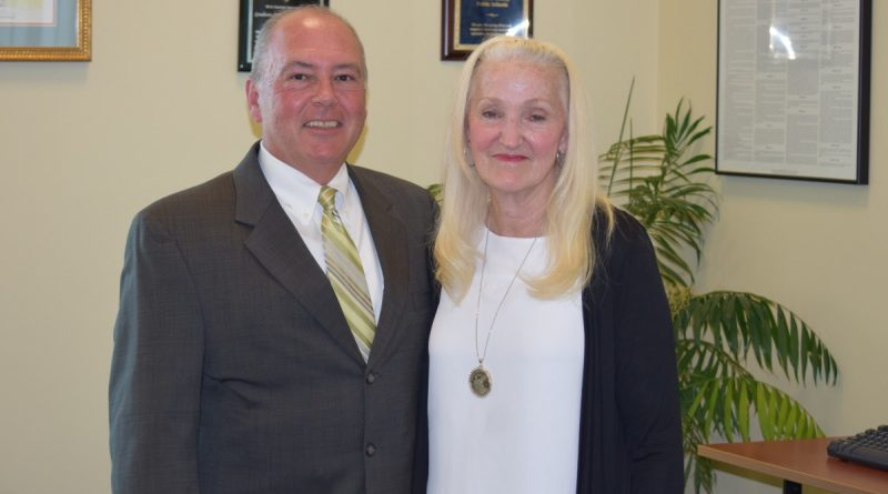 Janette Johnson poses with Shenandoah University's Director of Education Outreach Denny Keffer. (Courtesy of Loudoun County Public Schools)