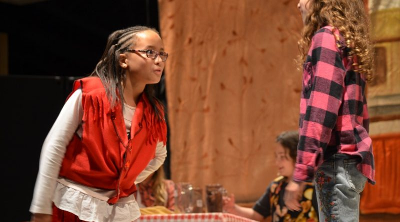 """From left, Lulubelle, played by Loudoun Country Day School student Logan Dearing scolds Jellybone, played by Beatrix Edmunds in Drama Kids' production of """"The Cleanest Town in Texas"""" on April 12. (Danielle Nadler/Loudoun Now)"""