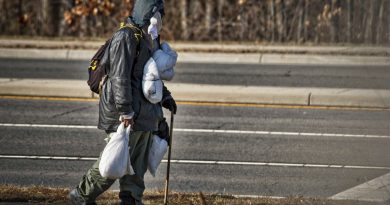 A man makes his way toward the county's homeless shelter on Sycolin Road in Leesburg. Loudoun County says the number of people without housing is at an all-time low, but the most recent homeless count has some critics. (Douglas Graham/Loudoun Now)