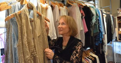 Jan Forman, owner of The Jeans Whisperer in downtown Leesburg, displays some of the styles that will be on parade at the May 18 Savvy Women of Northern Virginia fashion show. (Danielle Nadler/Loudoun Now)