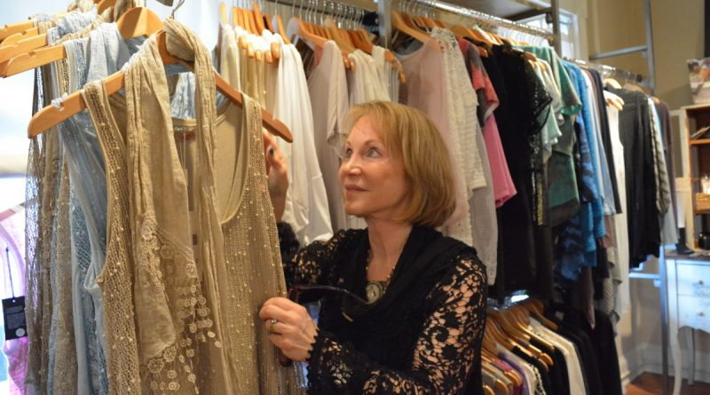 Jan Forman, owner of TheJeans Whisperer in downtown Leesburg, displays some of the styles that will be on parade at the May 18 Savvy Women of Northern Virginia fashion show. (Danielle Nadler/Loudoun Now)