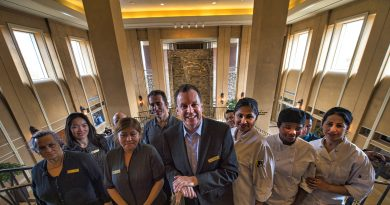 Managing Director Michael Stephens poses with his staff in the atrium of Lansdowne Resort.   [Douglas Graham/Loudoun Now]