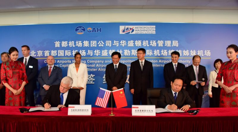 Mark Treadaway, MWAA's vice president for business outreach, and Wang Xing, executive vice president of Capital Airports Holding Company sign the sister airport agreement in Beijing on May 13.   [Visit Loudoun photo]