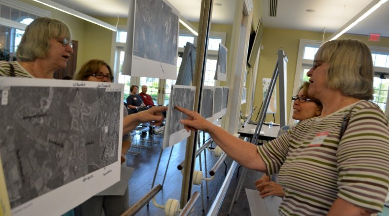 Rae Carson, who's lived on Braddock Road near Rt. 15 for 28 years, and a neighbor look at maps of the Transition Policy Area, meant to be a buffer between Loudoun's suburban development and rural land. (Danielle Nadler/Loudoun Now)