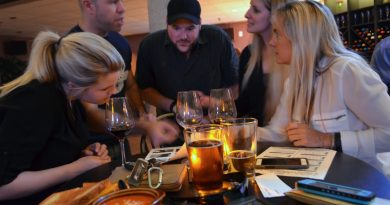 Who is the only player to win the Heisman twice? From left, Katherine Bolle, Taylor Jones, Ryan Craig, Elizabeth Bolle and Beckwith Bolle try to come up with the right answer at The Black Olive in Lansdowne. (Danielle Nadler/Loudoun Now)