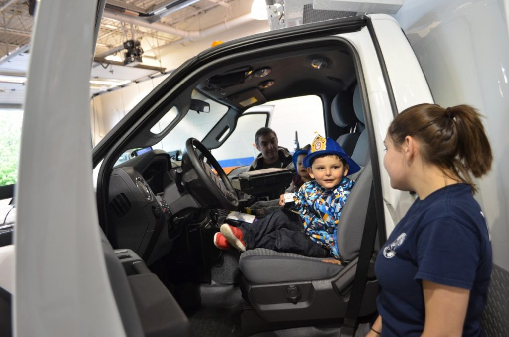 Three-year-old Max gets an up close look at an ambulance at the Loudoun County Volunteer Rescue Squad's open house. (Danielle Nadler/Loudoun Now)