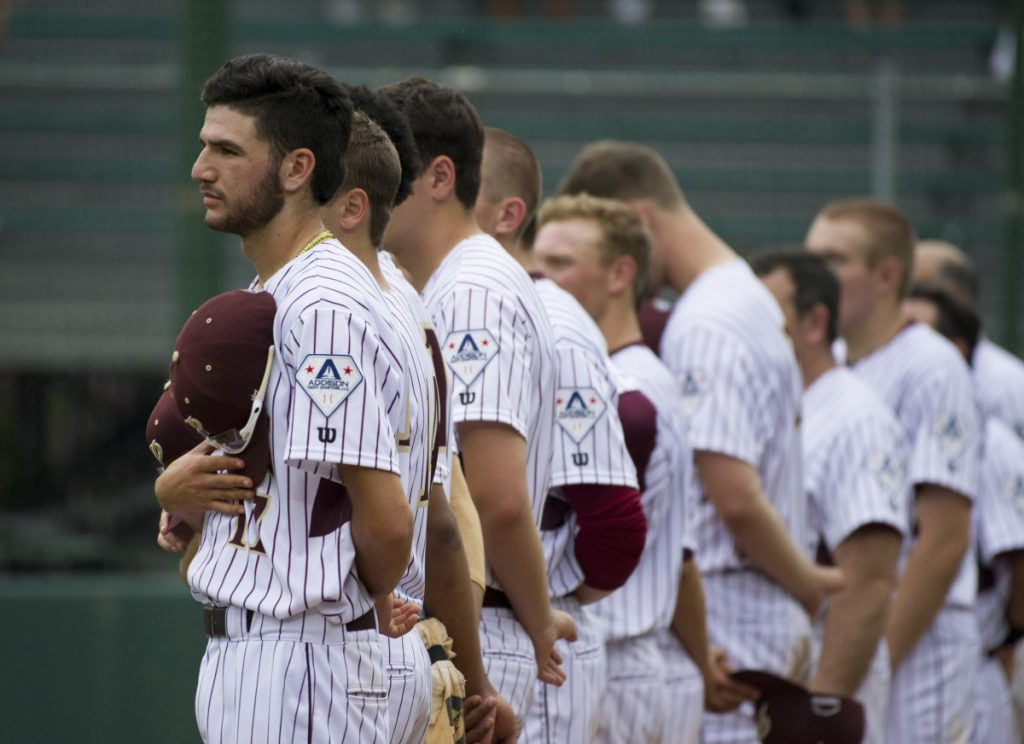 Players put their hands over their hearts during the singing of the National Anthem. (Douglas Graham/Loudoun Now)