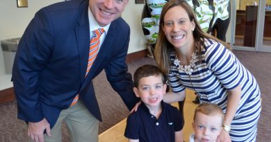 Christopher O'Rourke poses with his wife, Meghan, and sons, Myles and Riley, after he was formally hired as Briar Woods High School's new principal. (Danielle Nadler/Loudoun Now)